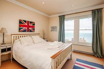 The spacious master bedroom is home to a king-size bed with sea views and and a gorgeous en suite.