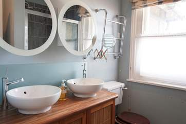 The en suite to the master bedroom with 'his and hers' sinks.