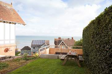 Doors open out from the lower ground floor and take you onto the lawned area and futher steps down to the decking.