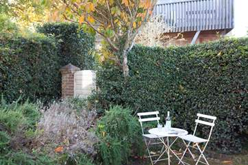 Situated in a quiet corner of the garden, enjoy the shade with a drink in hand.
