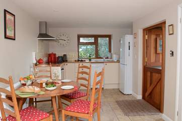 The well-equipped kitchen has an induction hob and a large fridge/freezer for all your holiday indulgences.