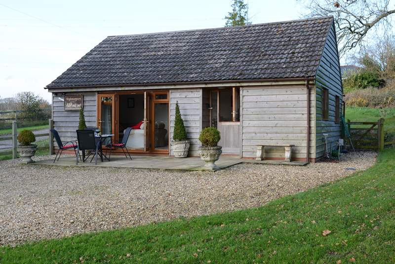 Cedar Lodge is cosy and compact, situated in a tranquil rural location with a fully enclosed garden.