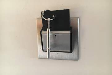 The key card needs to be inserted in the slot, just inside the front door, to activate the lighting in the cottage.