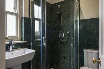 The shower cubicle in Bedroom 5 is lined with a beautiful green granite.