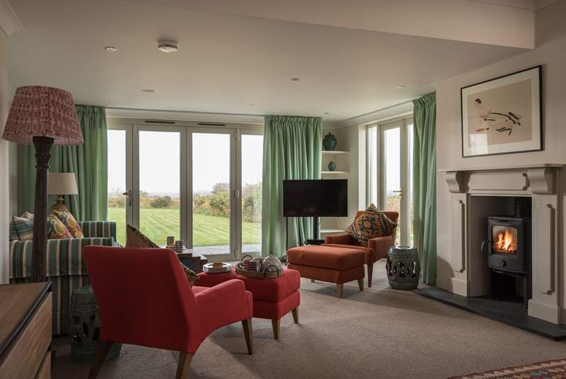 The big main sitting-area looks out to the garden and panoramic views.
