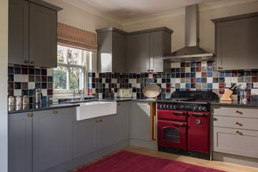 This is a custom-made, hand-built kitchen complete with range cooker.