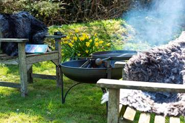 Cook up a scrummy supper on the fire-pit BBQ.