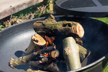 Cook up something scrummy on the fire-pit BBQ.
