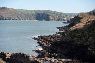 A view from the cliffs to Wild Pear Beach and Coombe Martin.