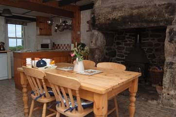 The dining-area with a huge inglenook fireplace and wood-burner.