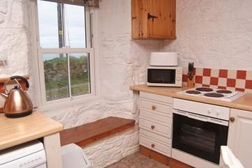 The kitchen-area has lovely sea views.