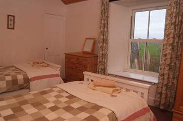The first floor twin bedroom has lovely sea views.