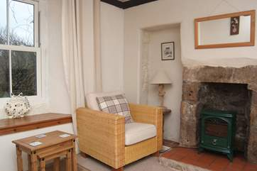 The sitting-room is heated by an electric stove.