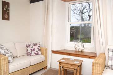 The ground floor sitting-room has views across the enclosed garden.