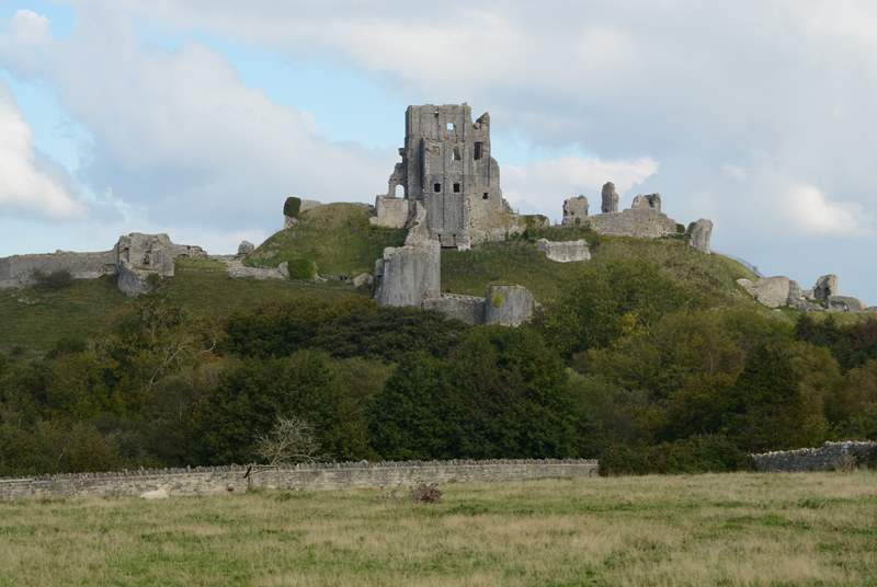 Iconic Corfe Castle, owned by the National Trust, dominates the pretty village of Corfe.