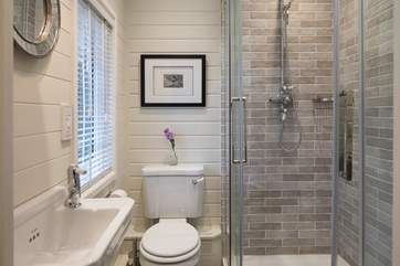The en suite shower-room has a drench head and  cosy heated towel rail.