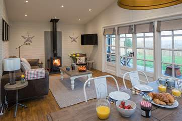 This delightful open plan space is perfect for sharing holiday time together and looks out over the private garden.