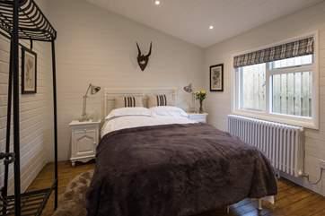 The master bedroom, Bedroom 1 has a super comfy 5 ft bed and en suite shower-room.