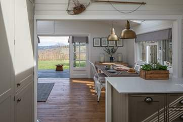 French doors lead out to the verandah and garden beyond.