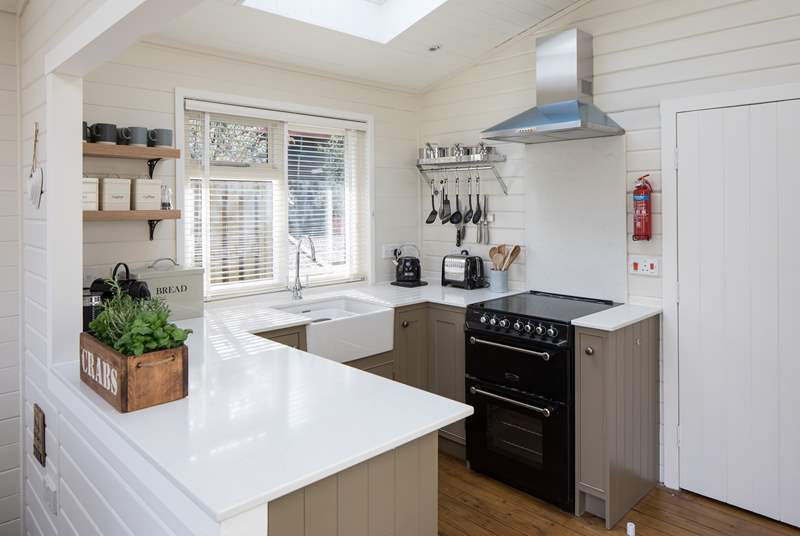 The bespoke kitchen is very well-equipped and has the bonus of a Nespresso machine.