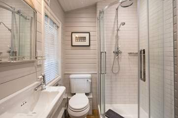The en suite shower-room has a drench head and heated towel rail.