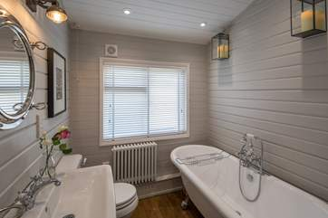 The family bathroom is stylish and cosy.