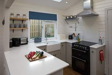 The bespoke fitted kitchen is very well-equipped to meet all your holiday needs, including a Nespresso machine.