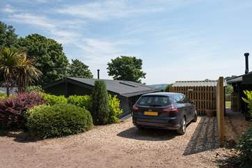 The parking area is beside the lodge, further cars can be parked on the quiet lane.