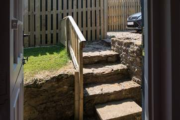 There are four steep steps from the parking area down into Lynchet Lodge.