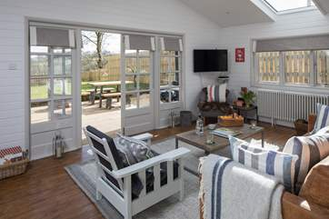 Stylishly decorated with French doors leading onto the decking and enclosed garden.