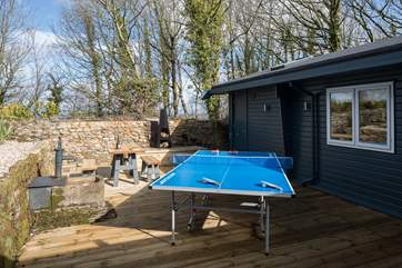 The rear courtyard is a sheltered sun-trap, ideal for a little competition on holiday.
