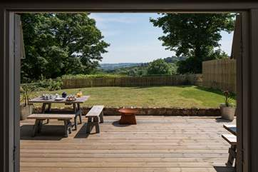 Fabulous views and French doors onto the deck, the fire pit has been removed.