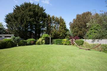 The beautiful secluded garden to the rear of the property is a lovely outdoor space in which to enjoy the sunshine.