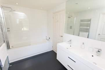 The Jack and Jill bathroom with bath, fitted shower and double sink.