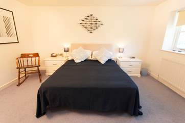 The master double bedroom, with access to the Jack and Jill bathroom.