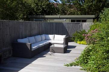 As the sunshine fills the garden, relax on one of many seating options outside.