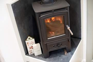 The wood-burner will keep you toasty whatever time of year.