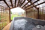 The bubbling hot tub, perfect for soaking up a starry night from - bliss!