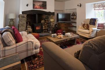 The main sitting-room boasts a fabulous wood-burner. Perfect for snuggling up and getting cosy.