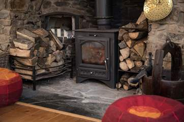 The beautiful wood-burner is the perfect complement to a cosy night in.