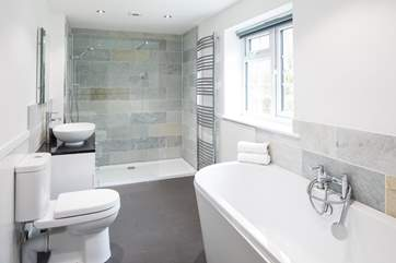 En suite to the master bedroom has a large bath and even larger walk-in shower.