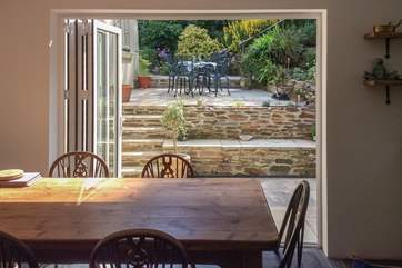 Swing open the bi-fold doors and step out of the kitchen onto the patio. Perfect for dining al fresco.