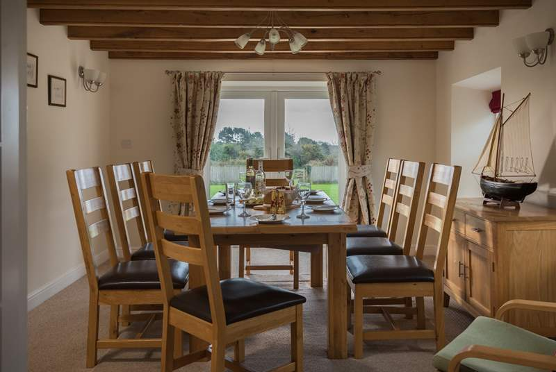 Room to dine with family and friends with views across the garden.