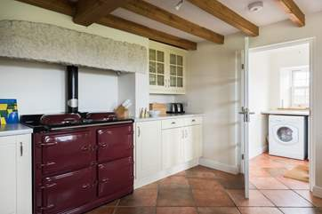 The kitchen also boasts a range cooker and separate utility-room by the back door to the garden.