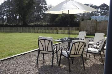 Relax in the sunshine in the private garden