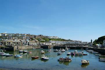 The nearby fishing harbour of Porthleven.
