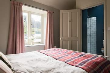 The double bedroom has a fabulous en-suite shower room.