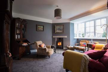 The snug sitting-room has a cosy wood-burner.