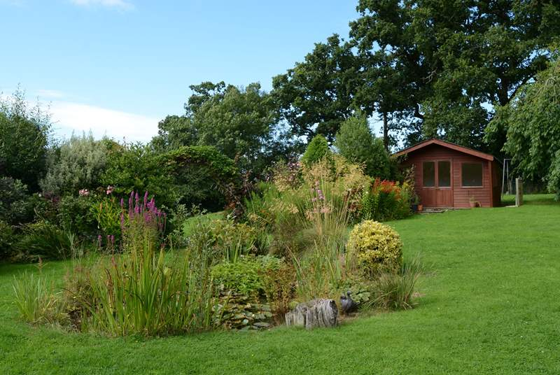 The summer-house faces south to make the most of the sunshine and views across the fabulous garden and the pond; please supervise children at all times.