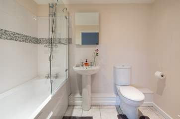 The en suite bathroom for bedroom 1 with a heated towel rail for toasty warm towels.